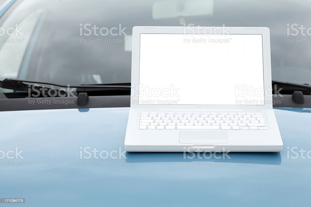 Laptop on car motorhood royalty-free stock photo