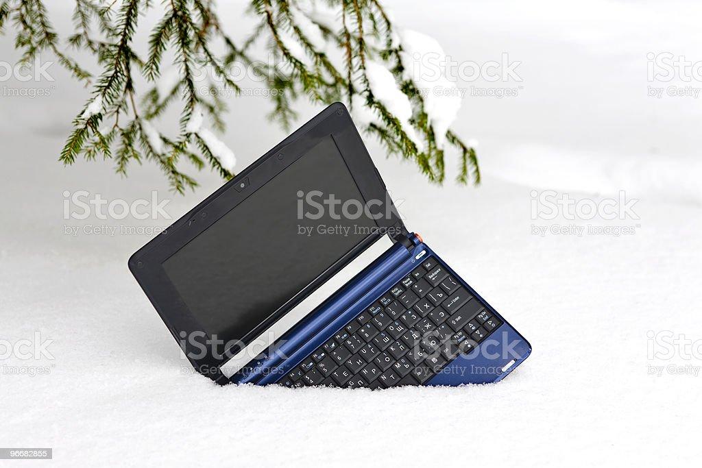 Laptop on snow stock photo