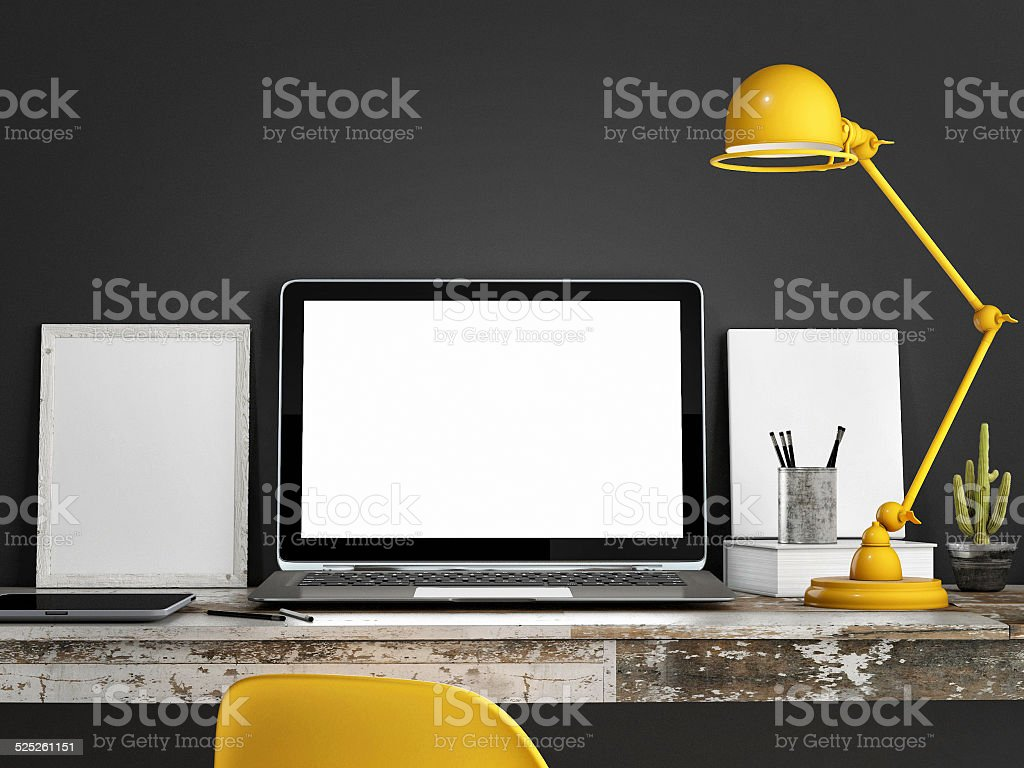 Laptop on table, Grey wall background stock photo