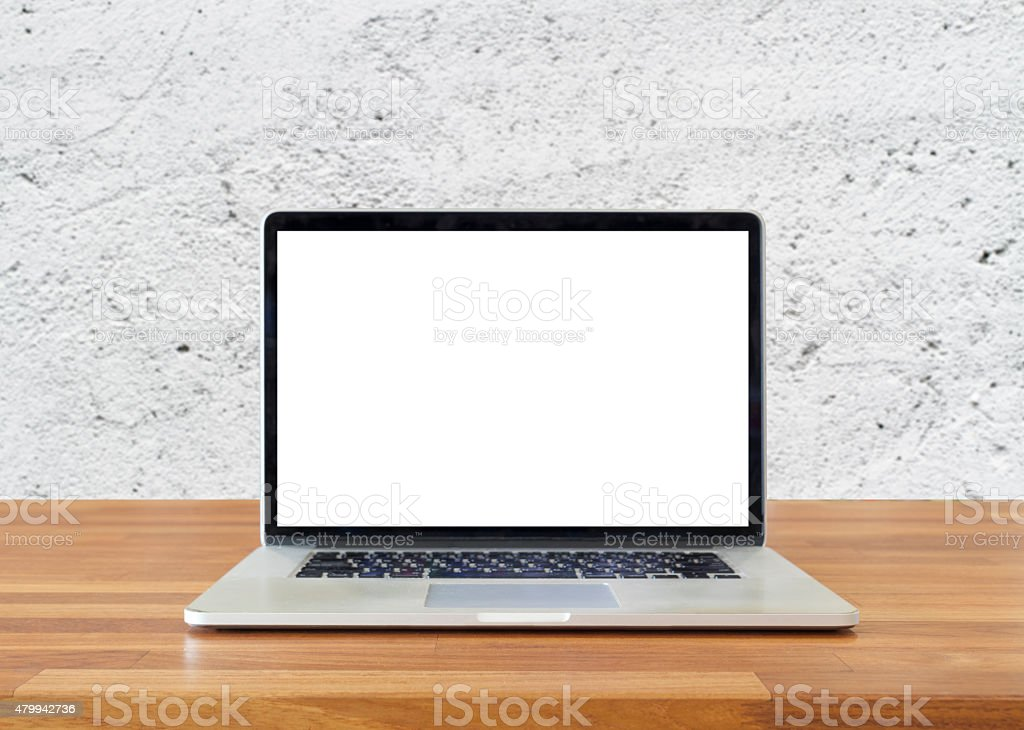 Laptop on table, on  white cement wall background stock photo