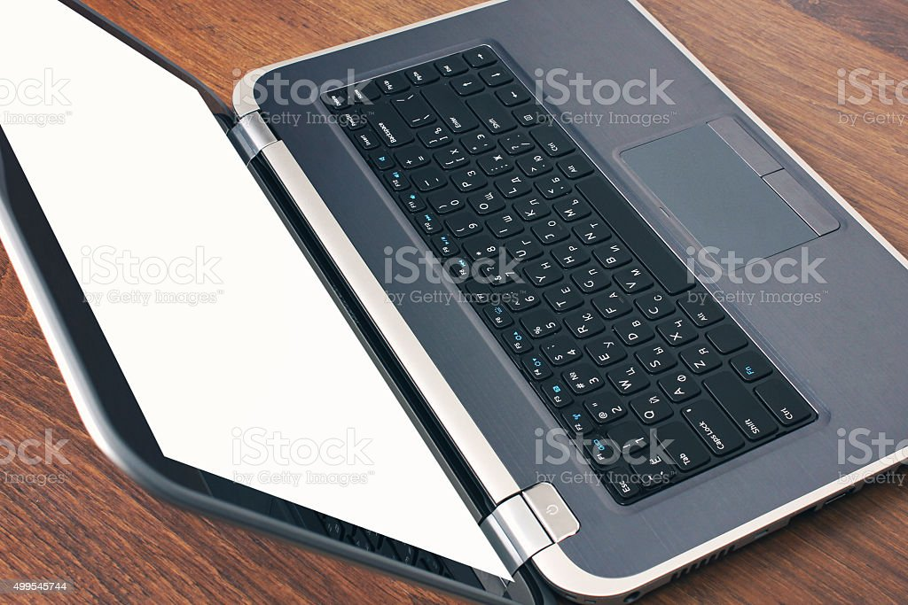 laptop on table stock photo