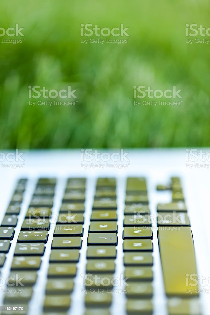 Laptop on the grass stock photo