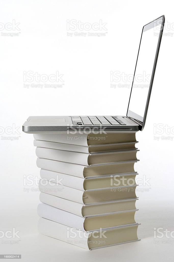 Laptop on the stacked blank books on white background royalty-free stock photo