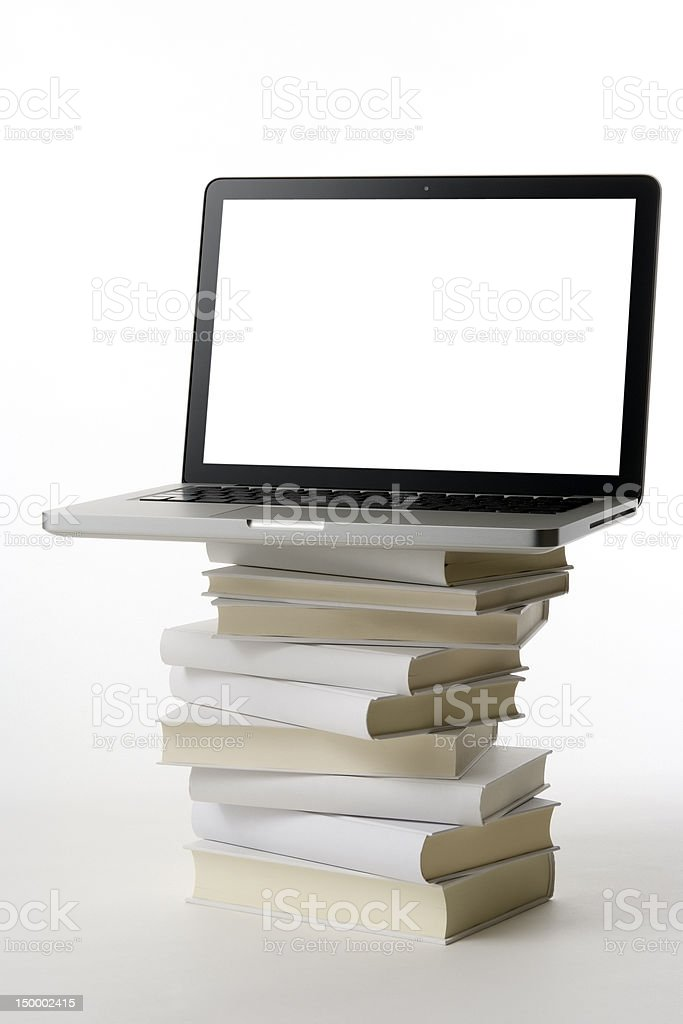Laptop on the stacked blank books on white background stock photo