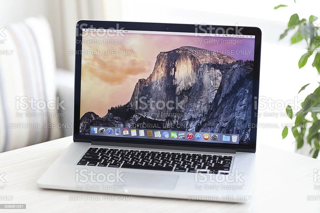 Laptop on white table royalty-free stock photo