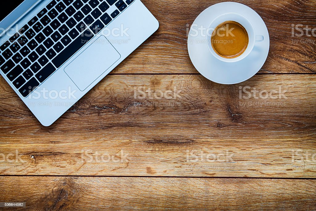 Laptop over on wooden table stock photo