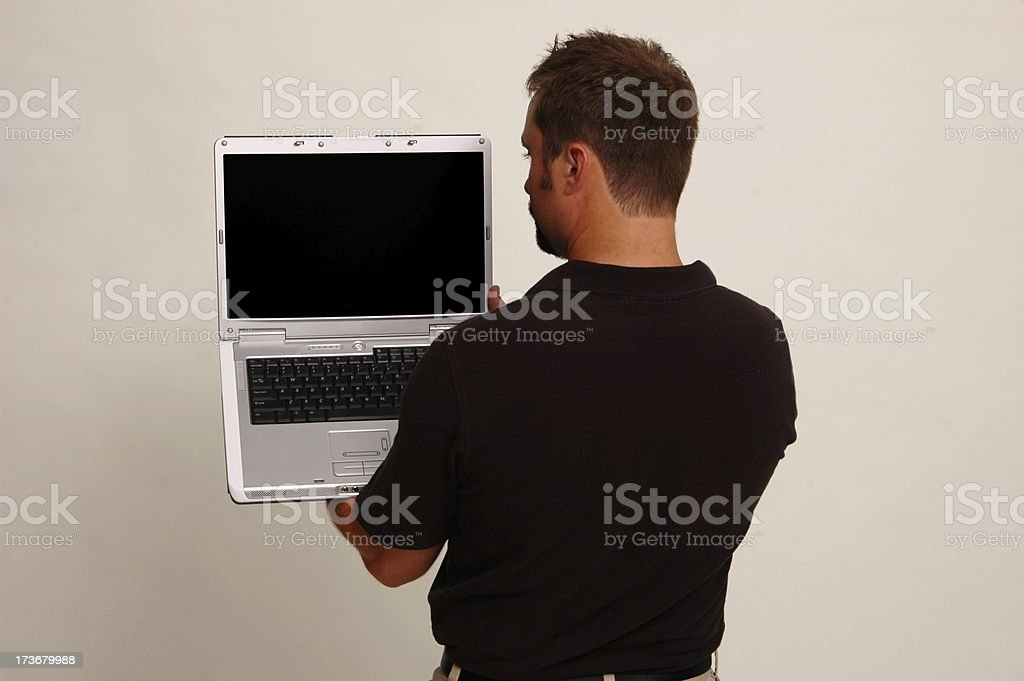 Laptop over the shoulder royalty-free stock photo