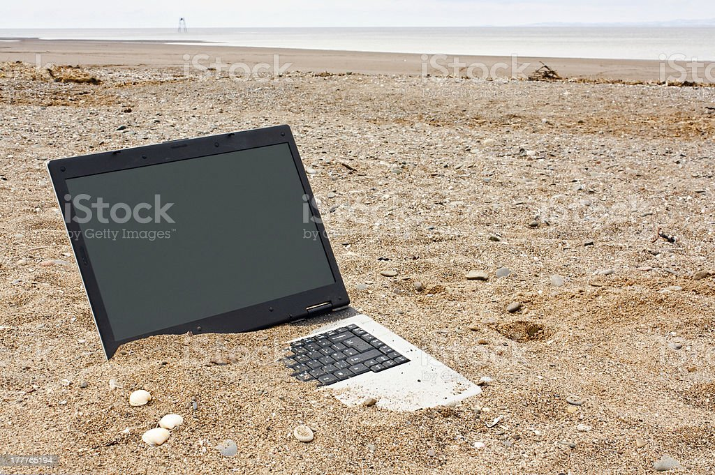 laptop personal computer on the beach stock photo