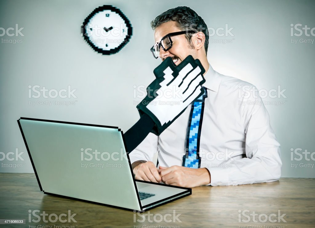Laptop slapping a businessman stock photo