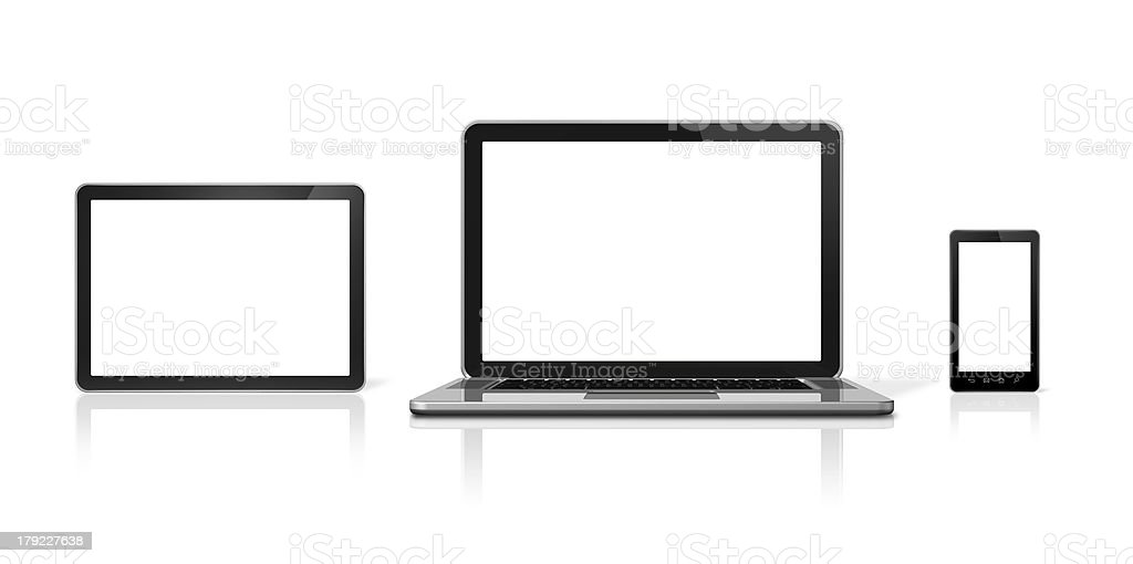 A laptop smart phone and a tablet all with white screens royalty-free stock photo