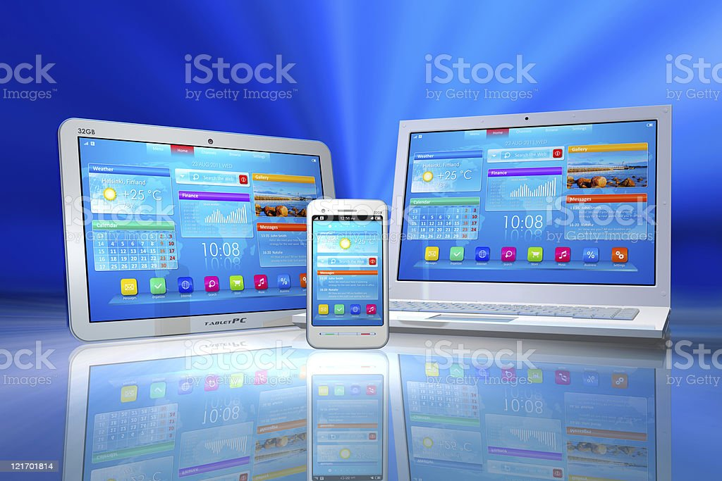 A laptop tablet and smartphone on a blue backdrop royalty-free stock photo