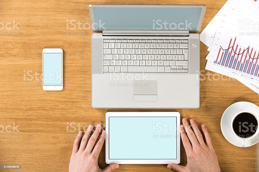 Laptop, tablet pc and smart phone on the desk stock photo