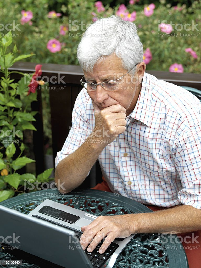 Laptop use outdoors royalty-free stock photo