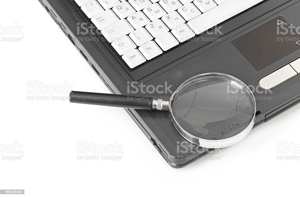 Laptop with a magnify glass royalty-free stock photo