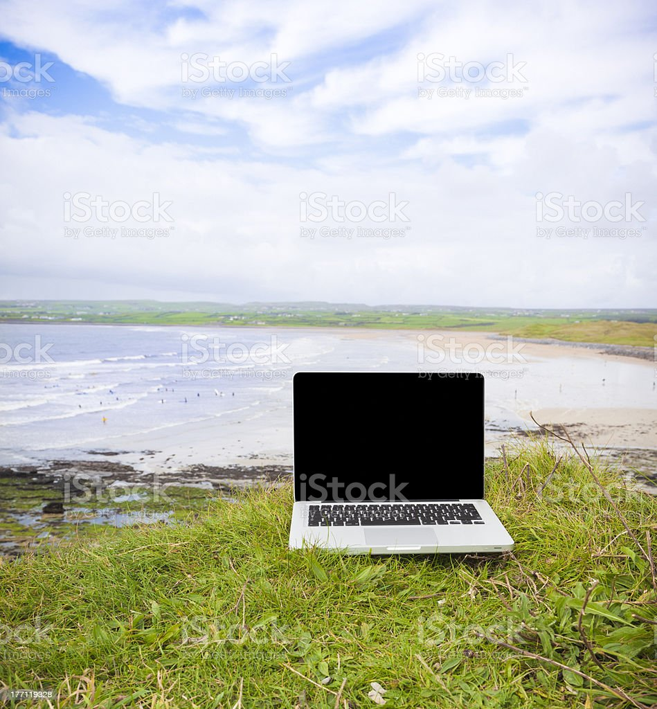 Laptop with Black Screen on the Cliff royalty-free stock photo