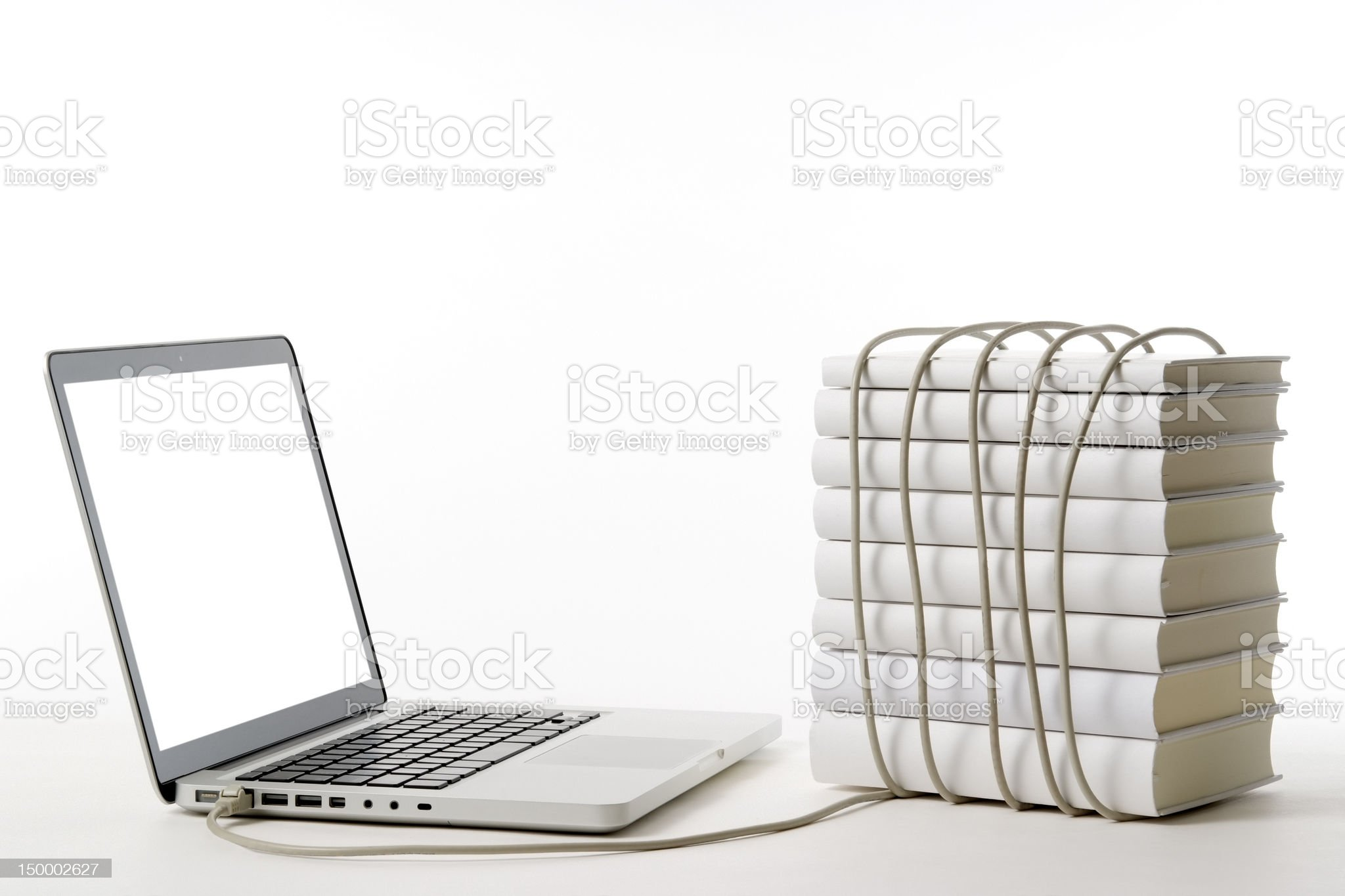 Laptop with blank books and USB cable on white background royalty-free stock photo