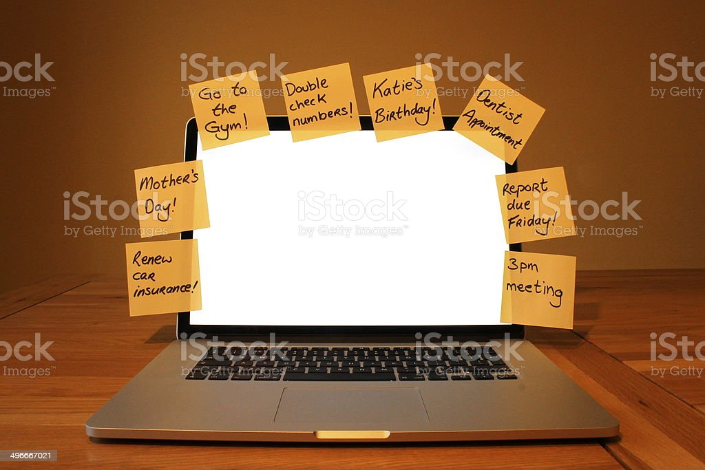 Laptop with blank screen and post it reminders stock photo