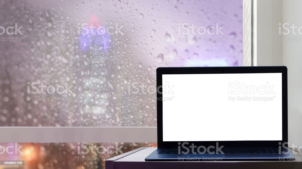 computer Labtop with blank screen on table at glass window of...