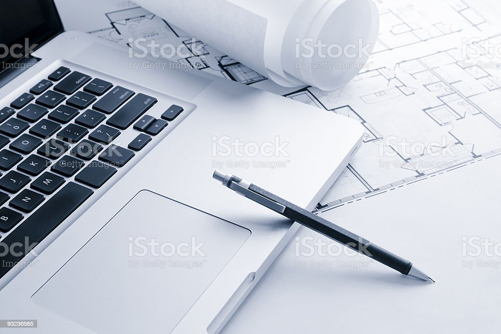Laptop with Blueprints and Mechanical Pencil royalty-free stock photo