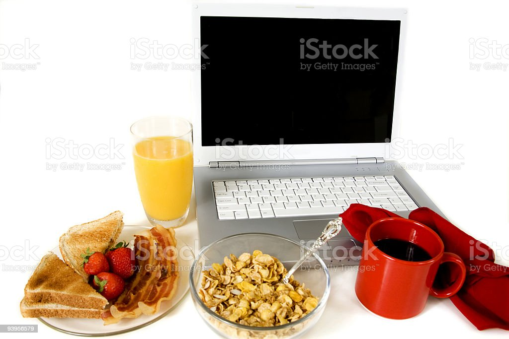 Laptop with breakfast royalty-free stock photo