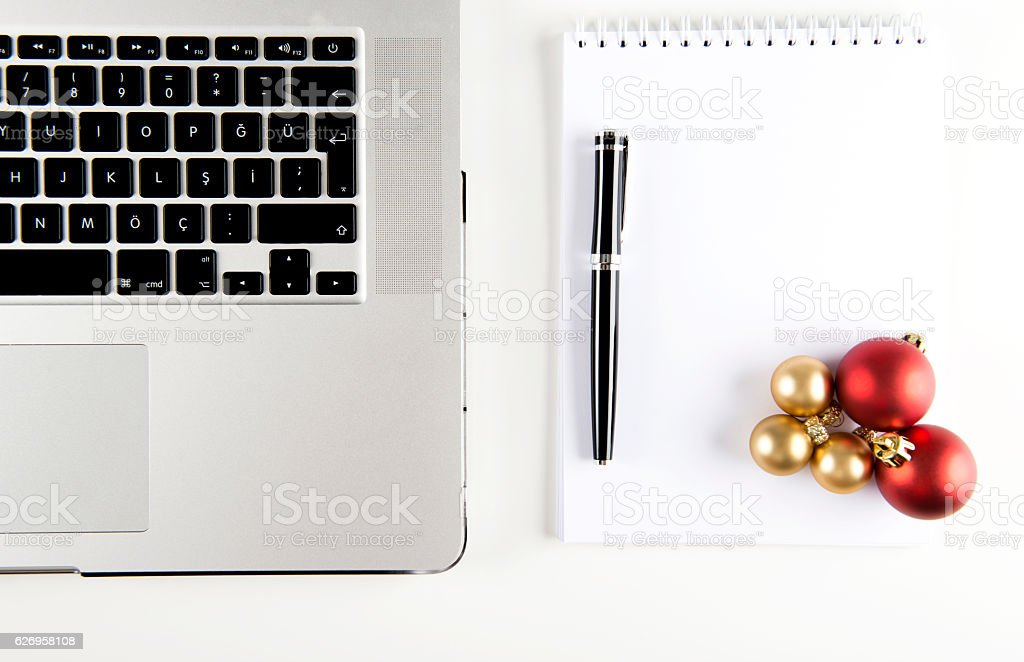 Laptop with Christmas Baubles stock photo
