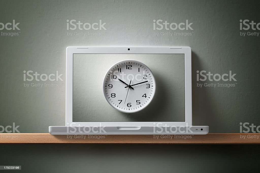 Laptop with clock. royalty-free stock photo