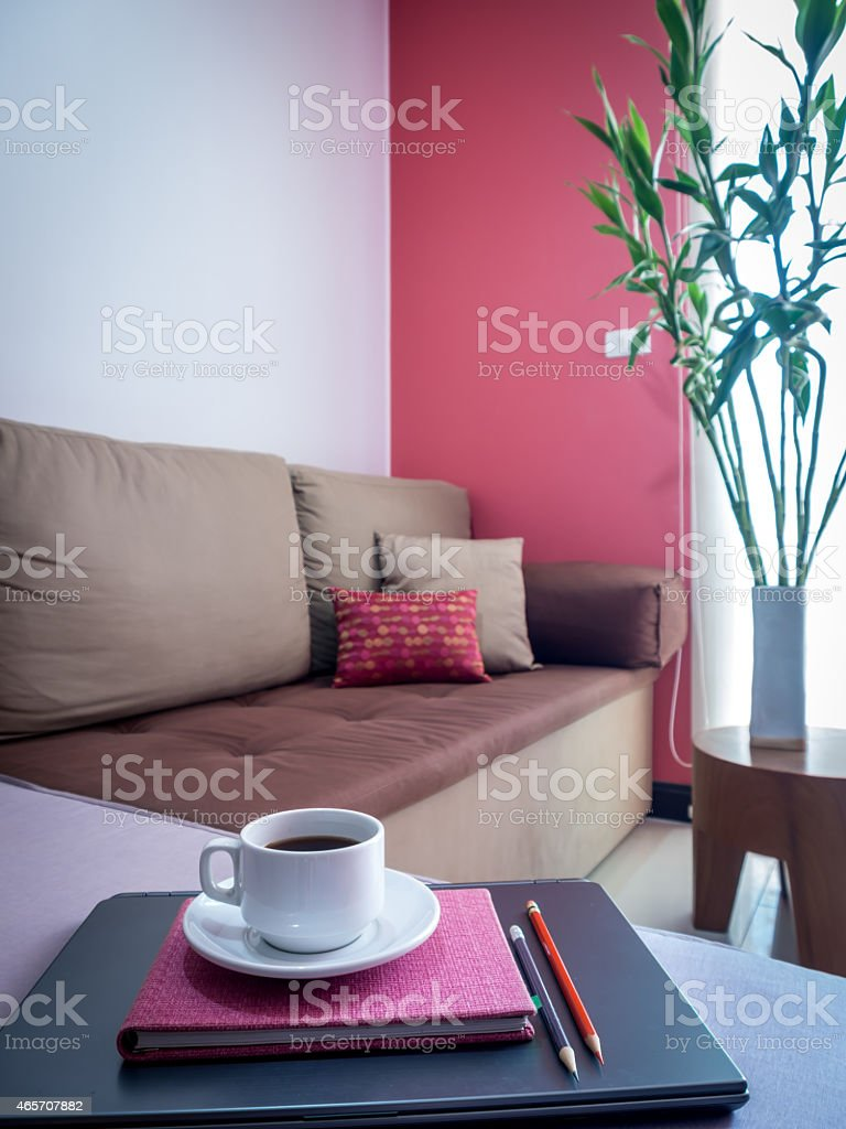 laptop with coffee cup on couch in modern Living room stock photo