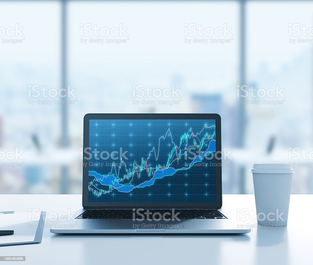 laptop with forex chart stock photo