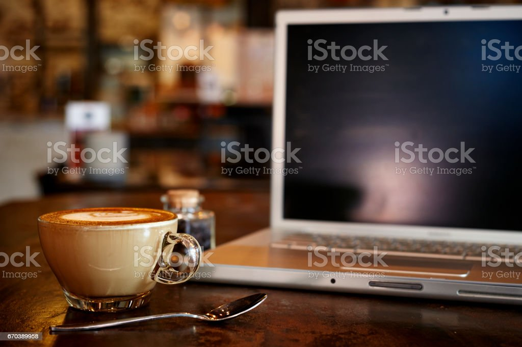 laptop with fresh cup of coffee stock photo
