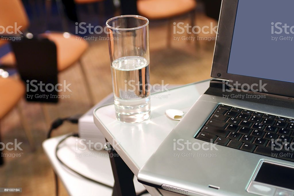 Laptop with glass on presentation royalty-free stock photo