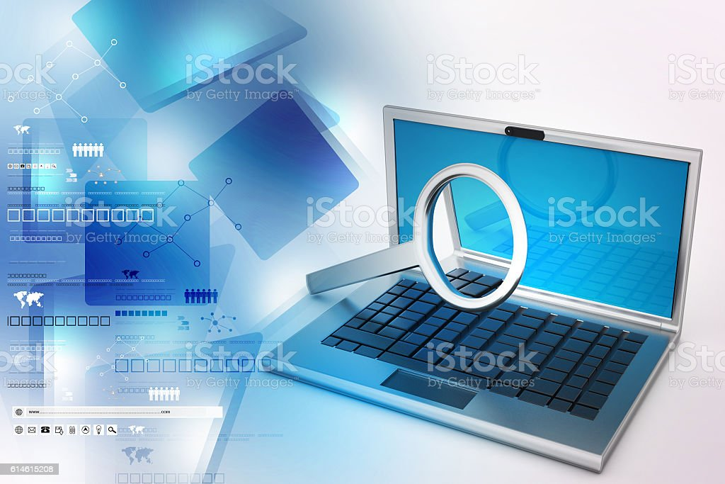 Laptop with magnifying glass stock photo