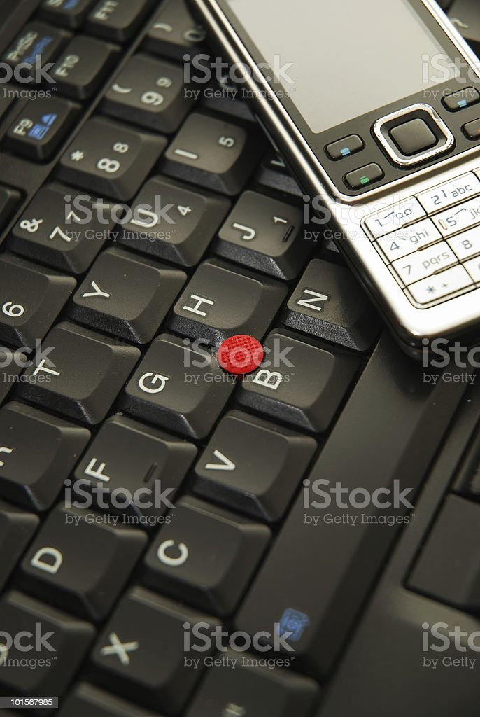 Laptop with mobile phone stock photo