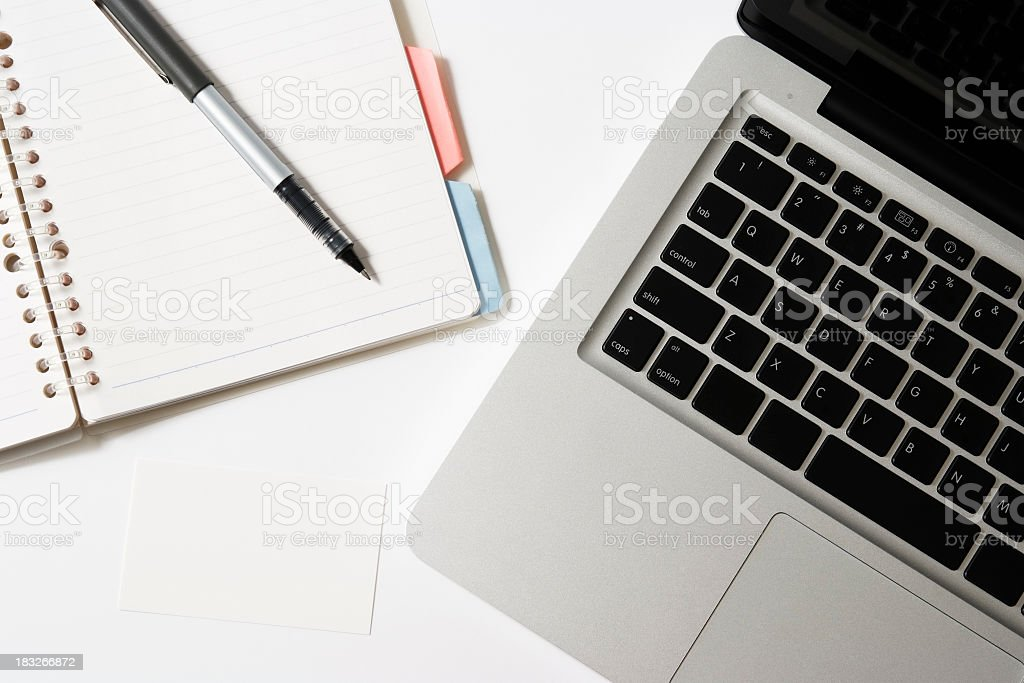 Laptop with notebook and blank business card on white background royalty-free stock photo