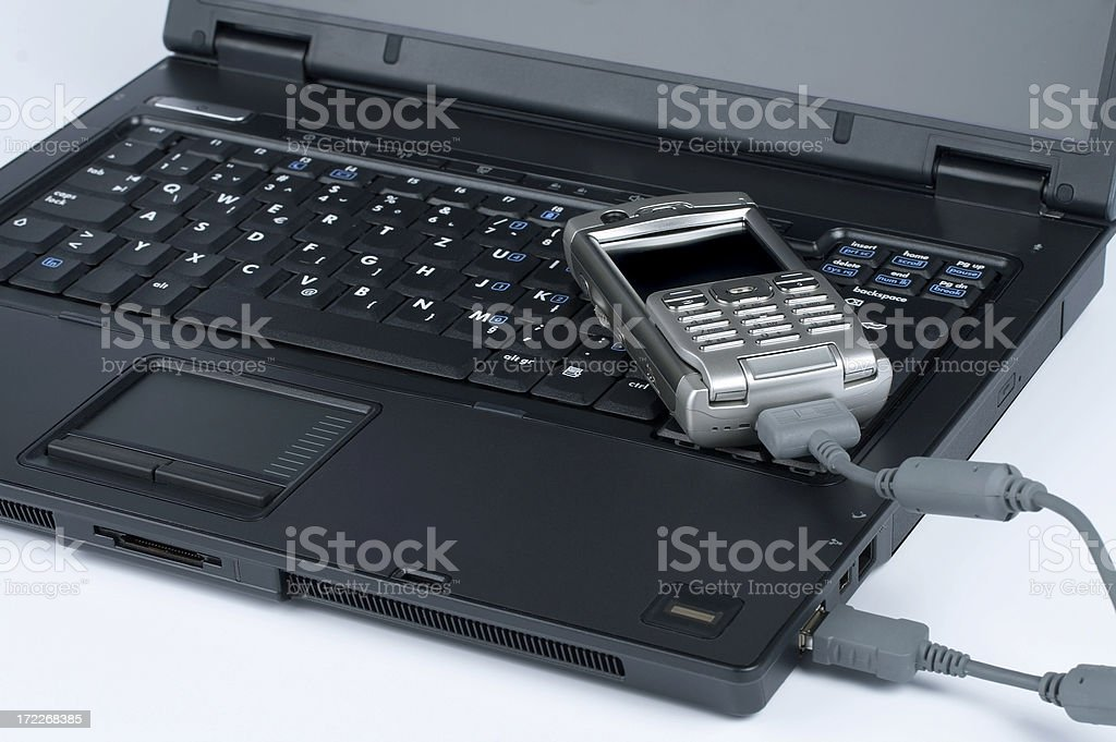 Laptop with PDA mobile phone royalty-free stock photo