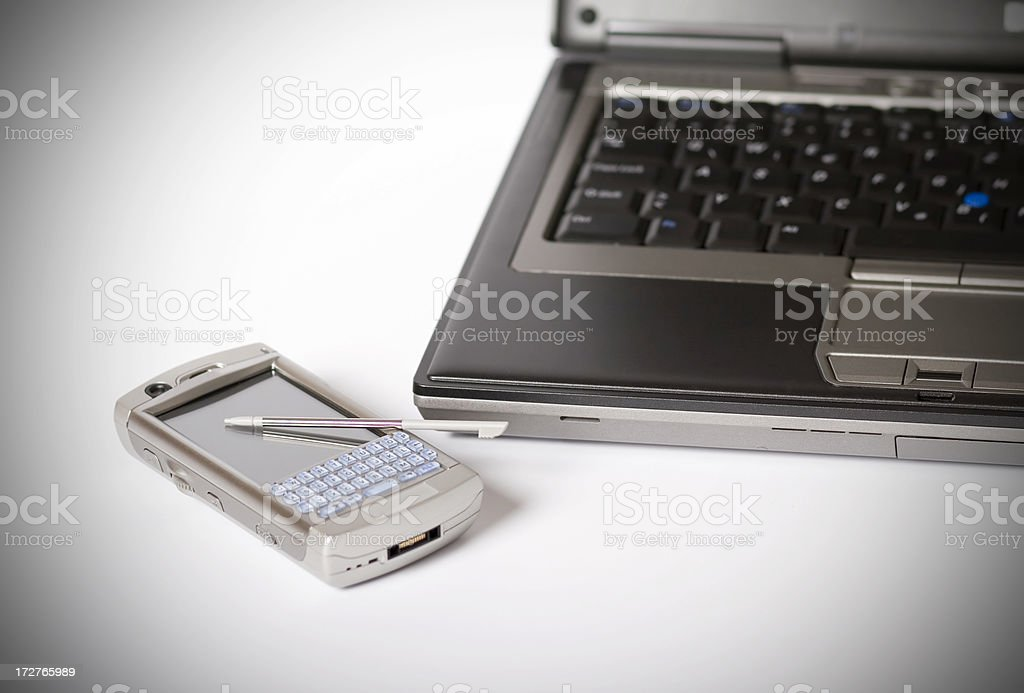 Laptop with PDA mobile phone stock photo