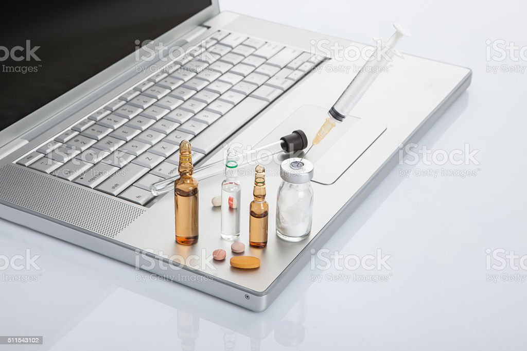 Laptop with Pills stock photo