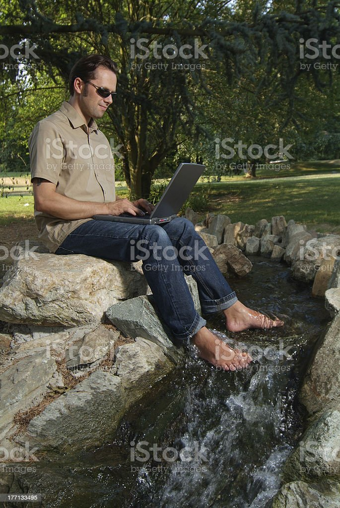 laptop-work in the park stock photo
