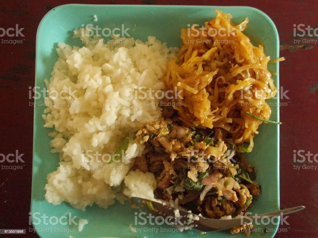Larb moo and Padthai served with cooked rice. stock photo