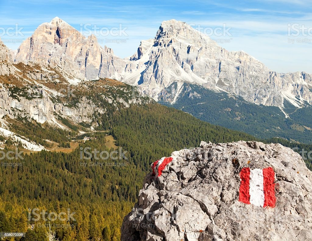 Larch wood, tourist sign and Le Tofane Gruppe, Dolomiti, Italy stock photo