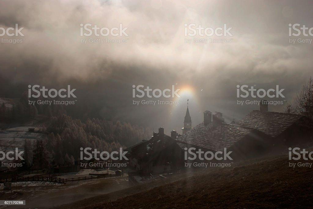 l'arcobaleno sopra il campanile stock photo