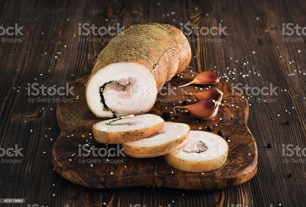 Lard roll with salt and garlic stock photo