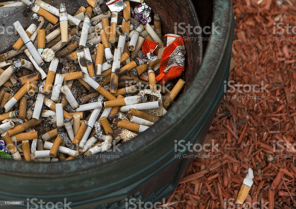 large accumulation of cigarette butts stock photo