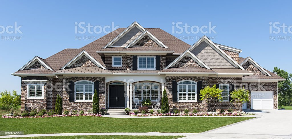 Large American detached home with garden and blue sky stock photo