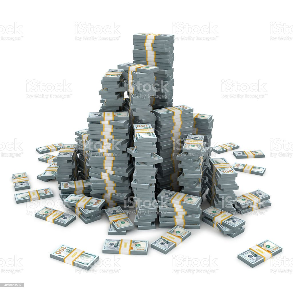 A large amount of dollar notes stacked in a pile stock photo