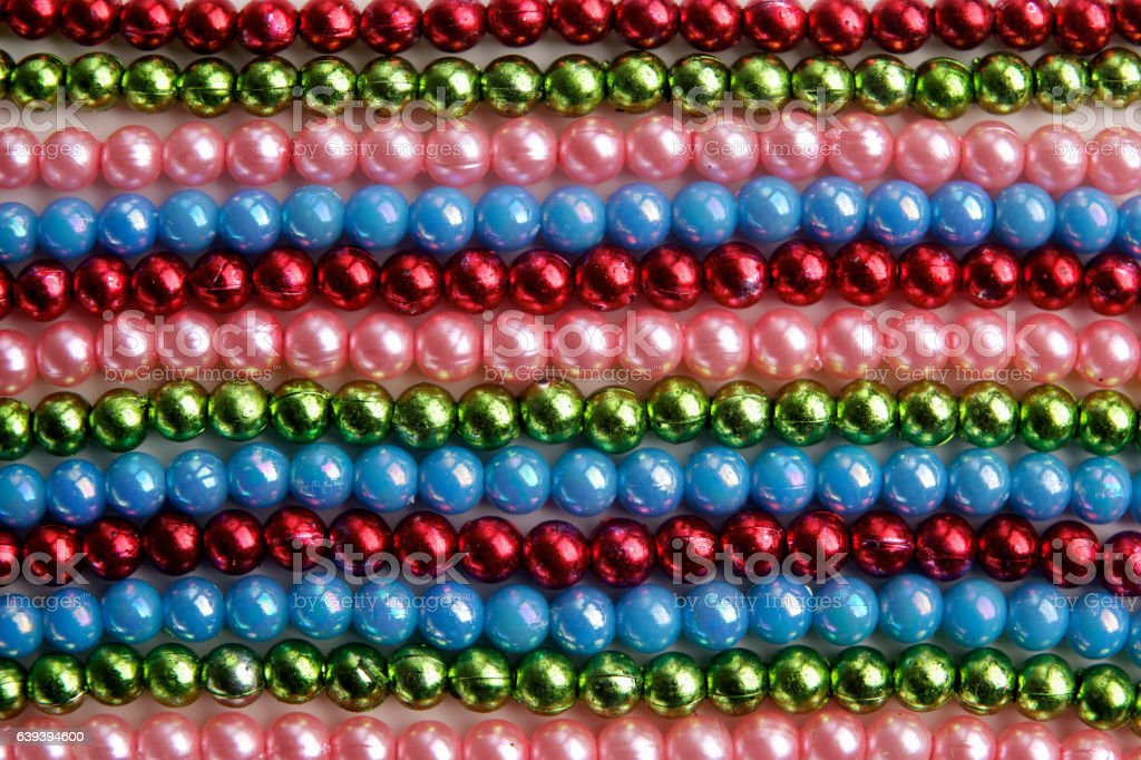 Large amount of madri gras bead background. Top view stock photo