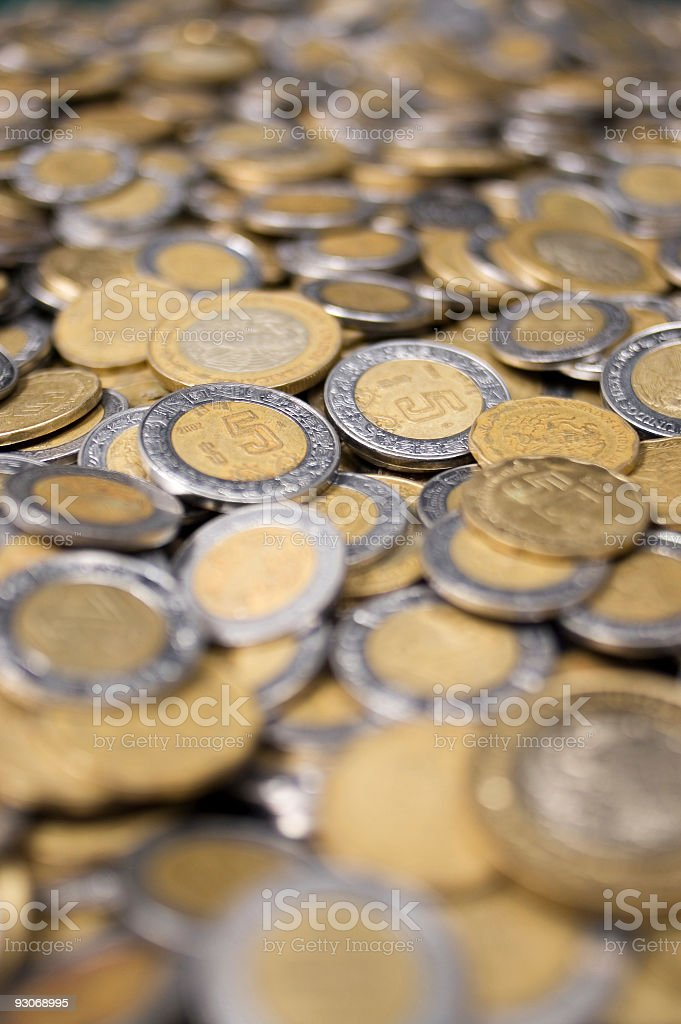 Large Amount of Mexican Peso Coins stock photo