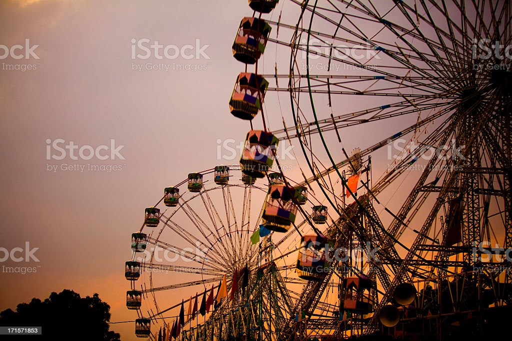 Large amusement park with two giant wheels stock photo