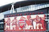 Large Arsenal logo and billboard on Emirates Stadium