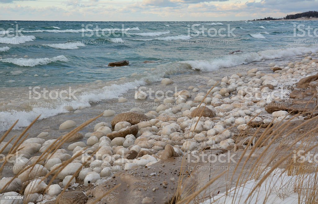 Large Balls of Ice and Snow Line the Beach royalty-free stock photo