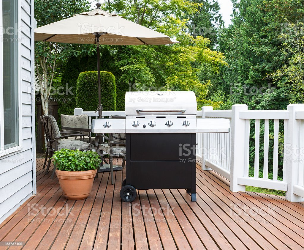 Large barbecue cooker on cedar deck stock photo